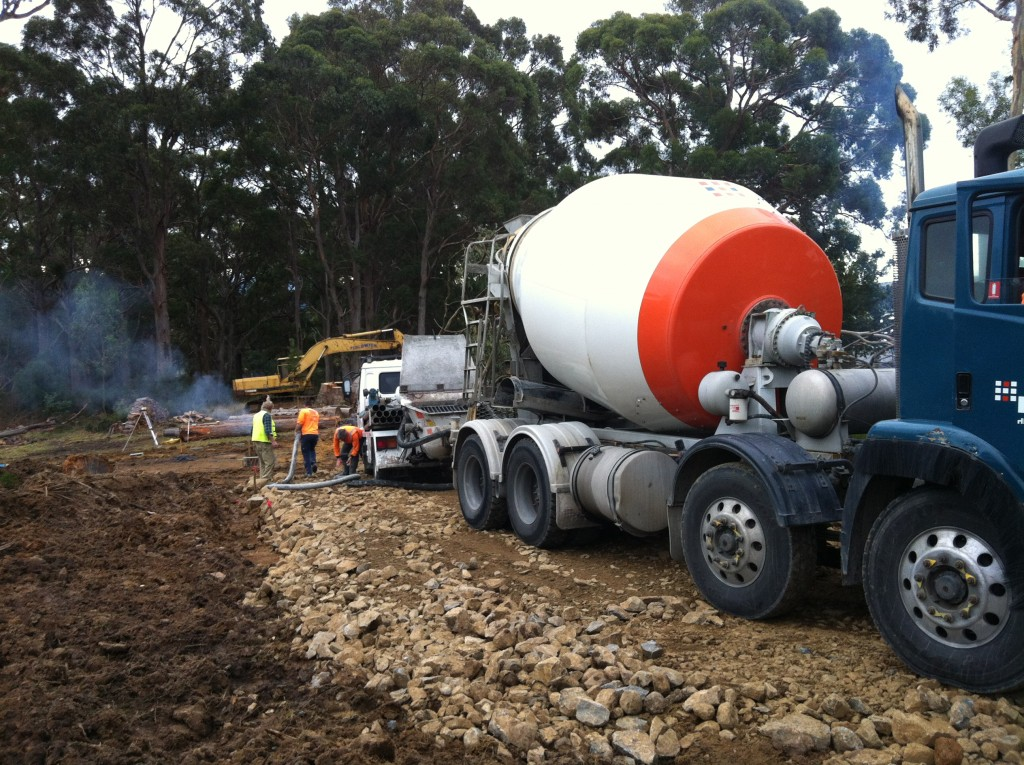 The pump truck and concrete truck on the freshly made driveway