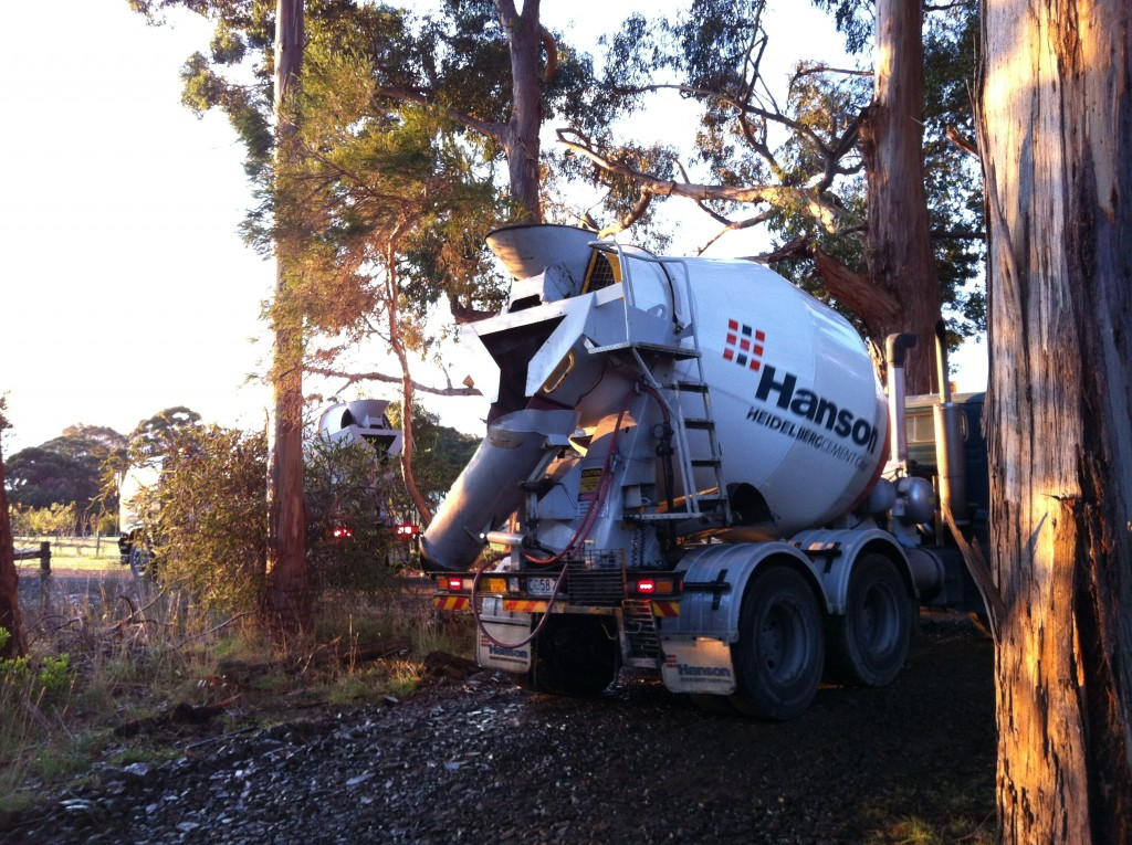 The morning of pouring the slab: one concrete truck waits for the other to leave
