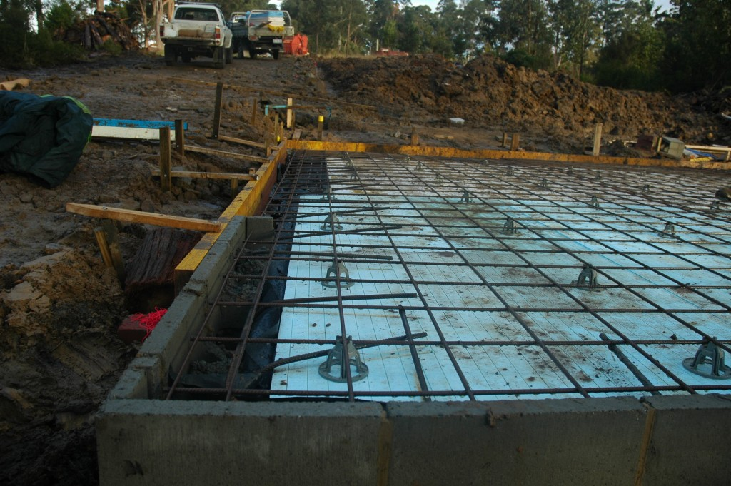 The steel reinforcing in place and straight edge formed for the concrete slab to be poured