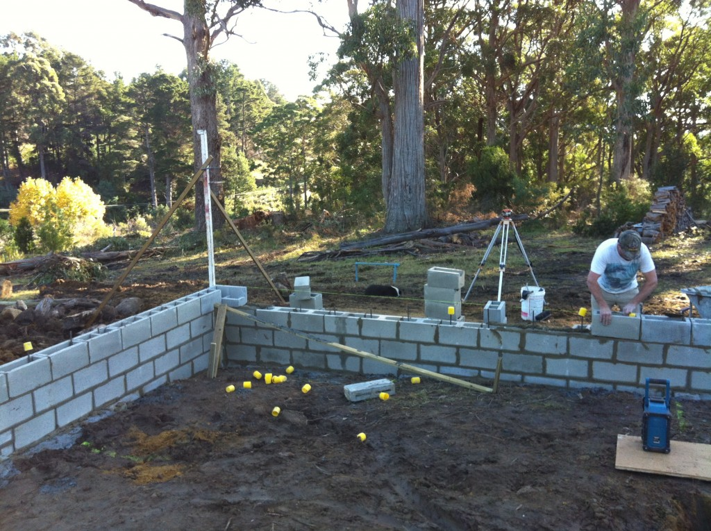 Scott laying the top course of blocks