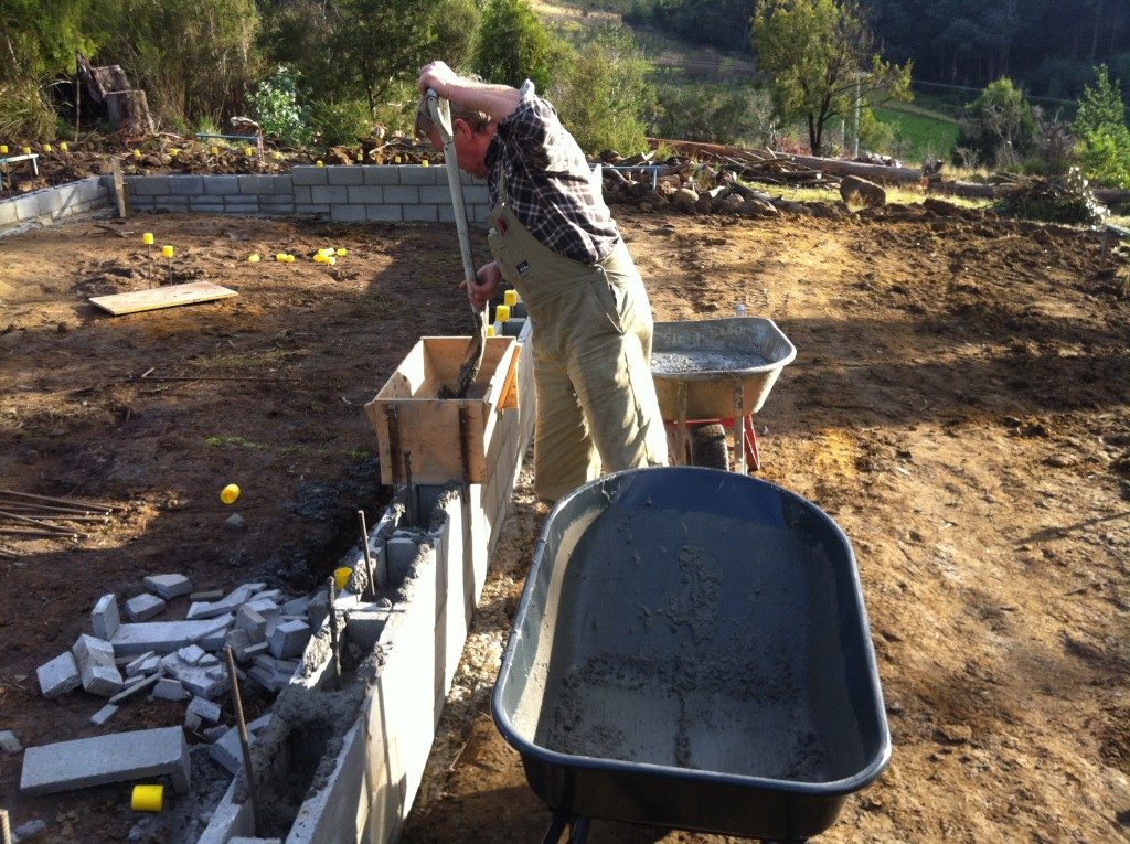 Greg filling the blocks with concrete