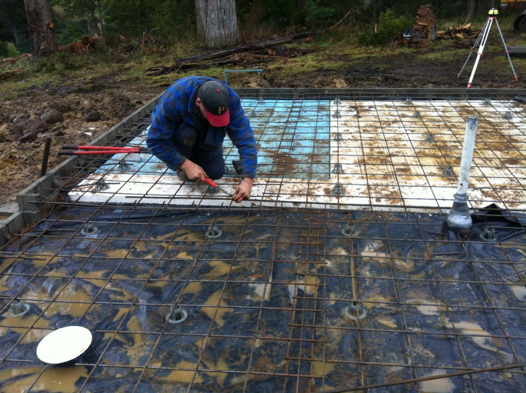 Steve tying the sheets of reinforcing together; the set down in the slab for the wet area