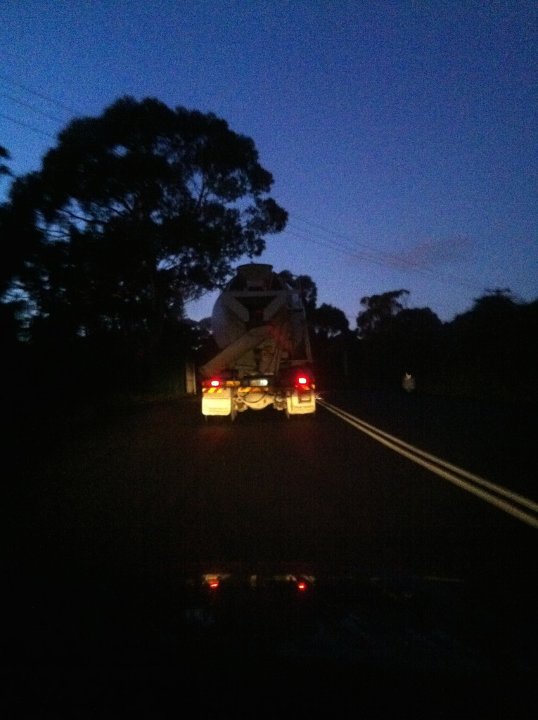 Early start: stuck behind the first concrete truck while driving to site before sunrise