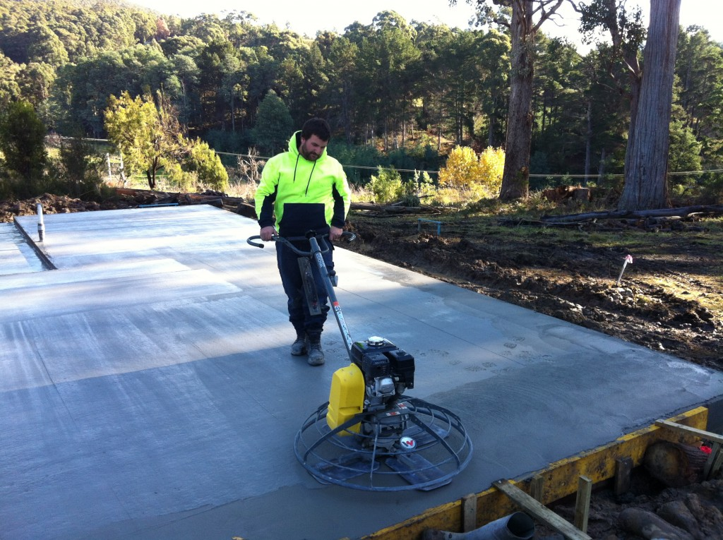 Flying solo: Stuart pilots the 'helicopter' - a mechanical tool for finishing concrete slabs