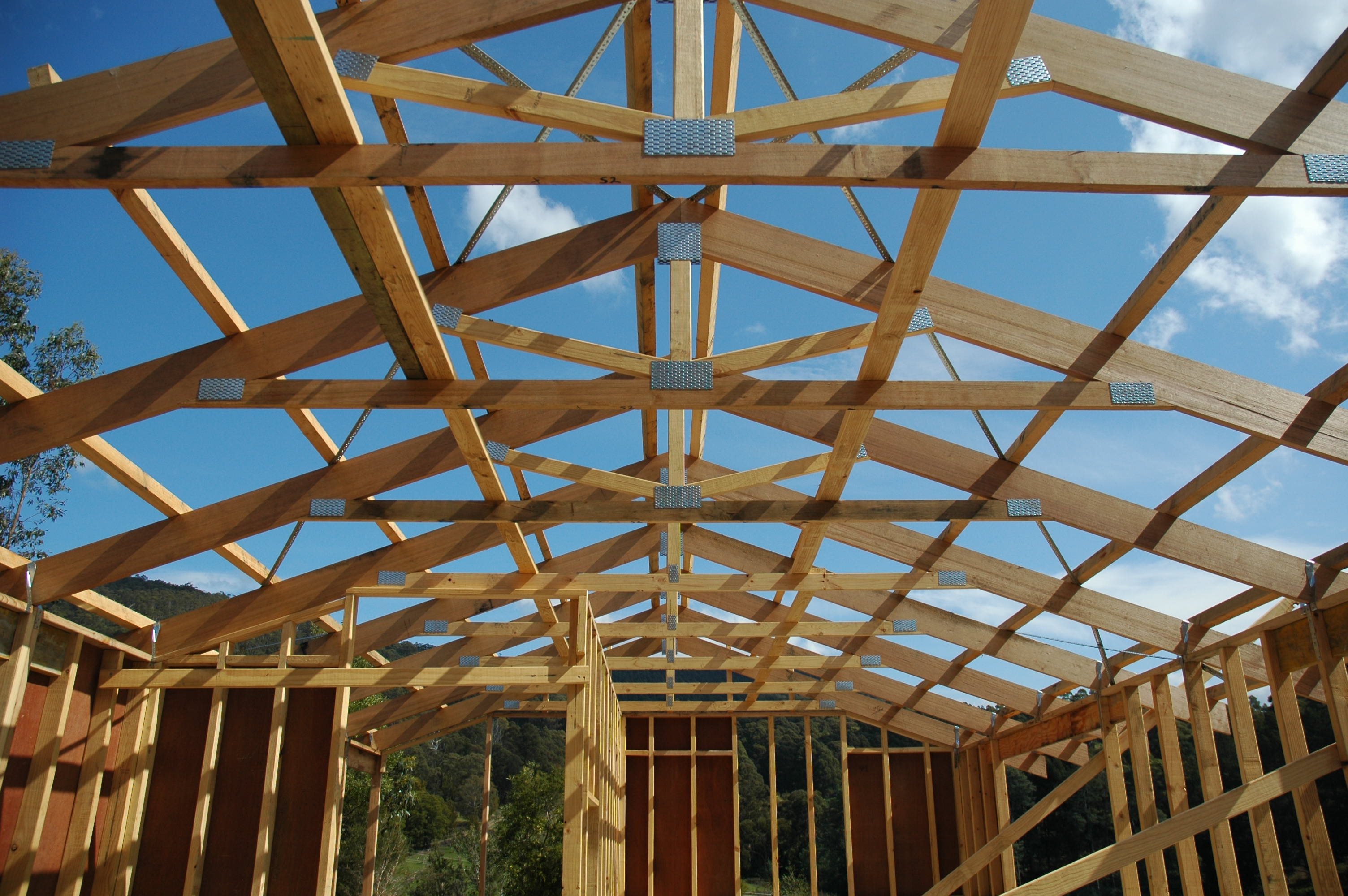 Framing the roof 60k house for Roof trusses