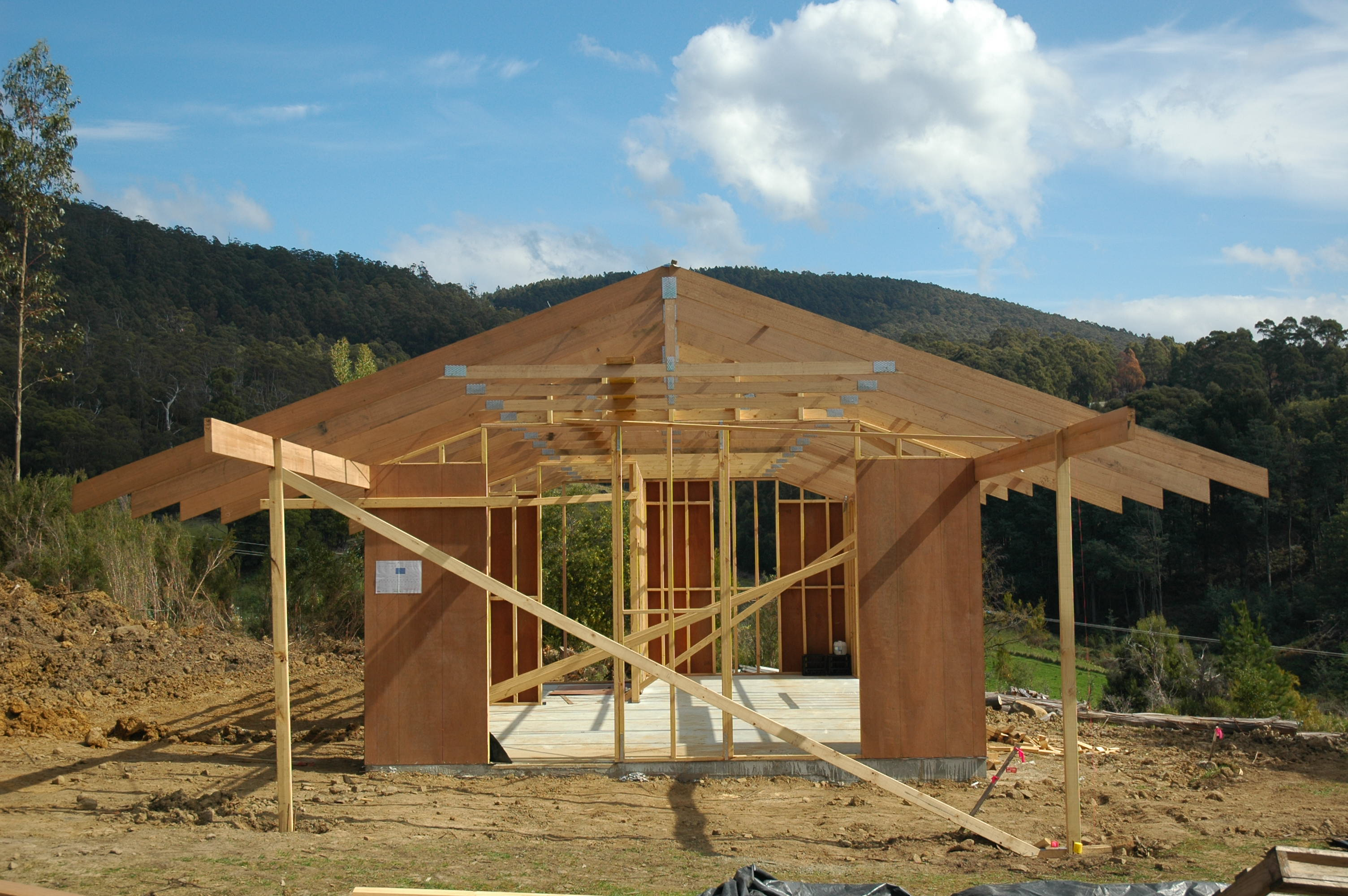 Framing the roof 60k house for Price of roof trusses
