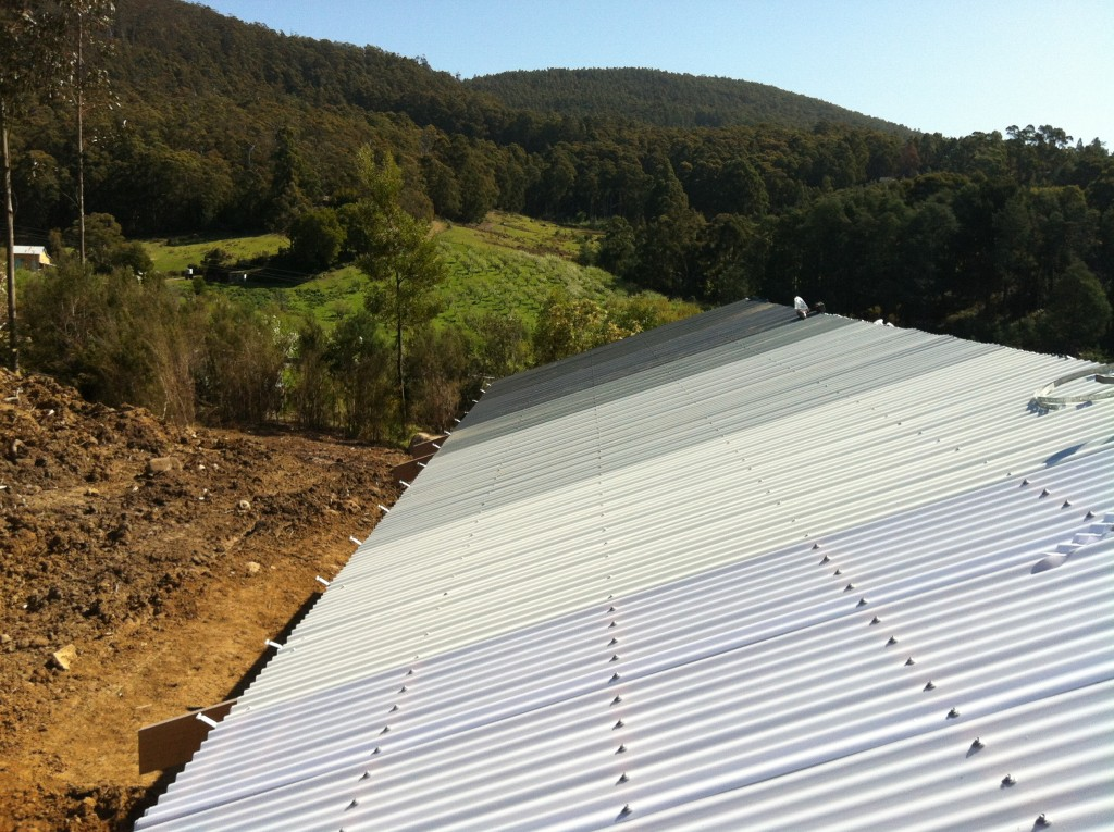 Looking over the roof to the apple orchard and valley beyond