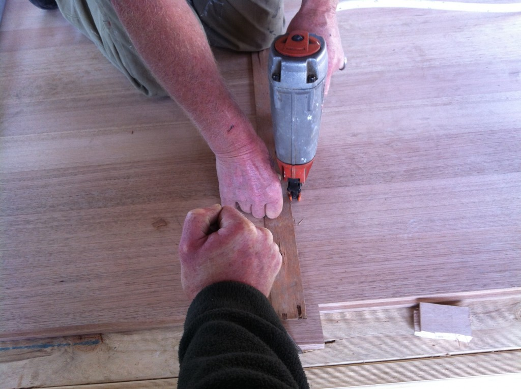 Nailed it: nailing the floor boards in place
