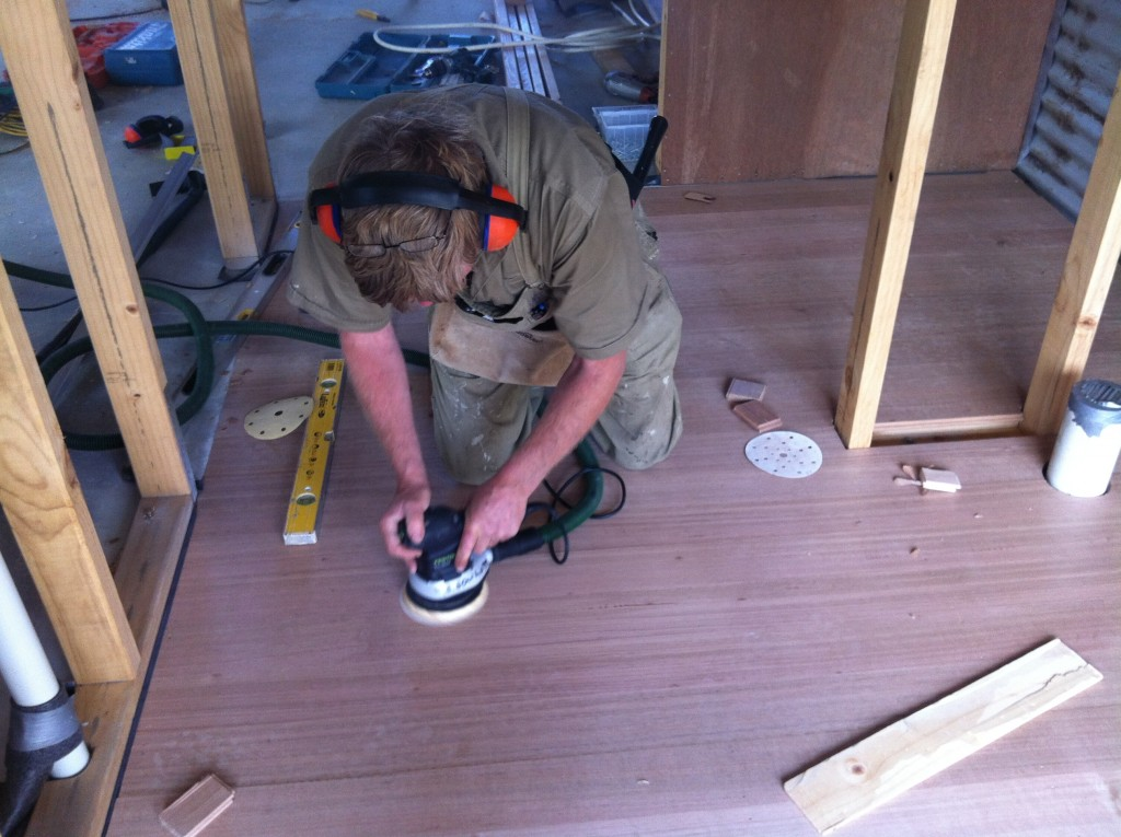 Smooth operator: sanding the floor boards for a smoother finish