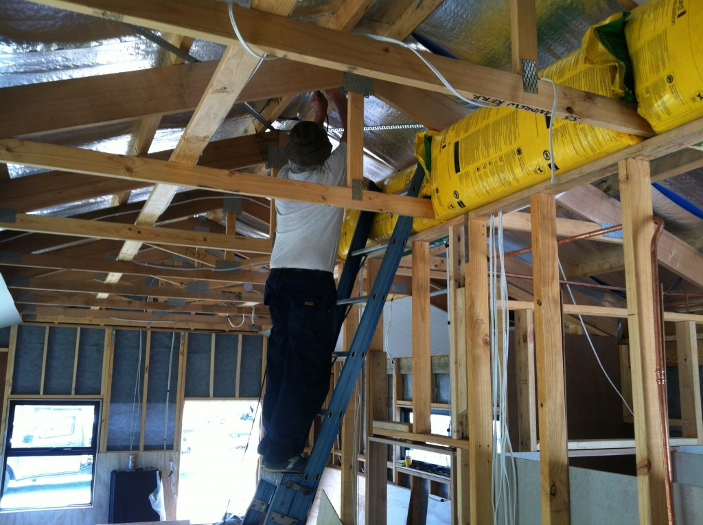 Coming down: pulling the coaxial cable down from the aerial through the roof
