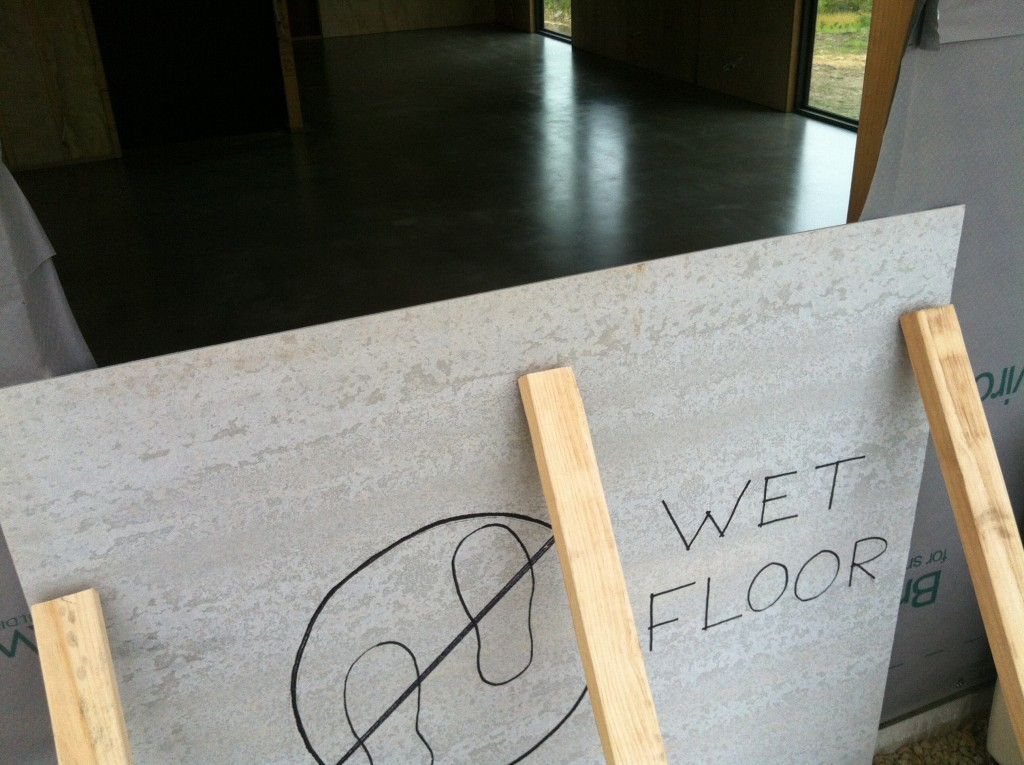 Sign of the times: home made sign indicates not to do the Tassie two-step dance on the wet floor