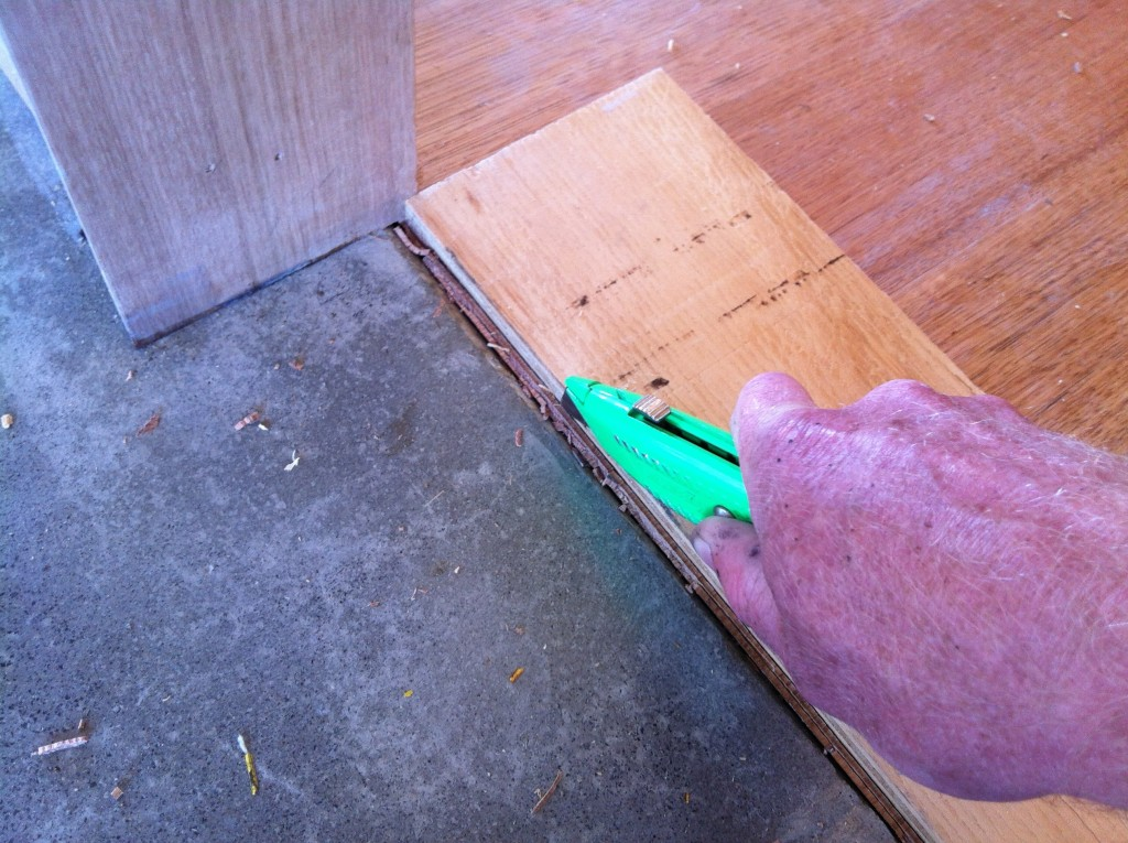 A thousand cuts: cutting the ends of the floor boards to make way for a a bead of silicone where the two materials meet
