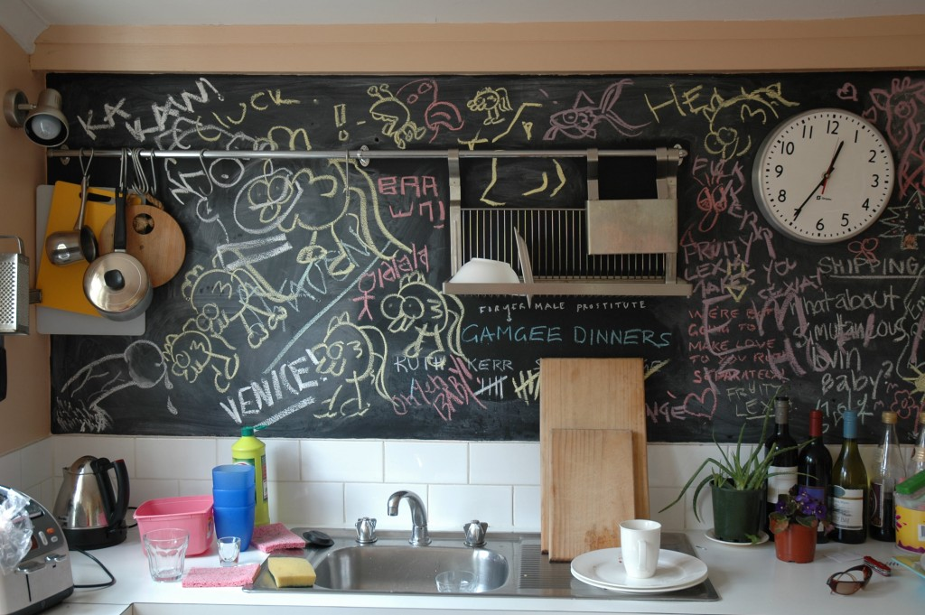 Fun for the whole family: a blackboard splash back can be useful for lists and creative pursuits