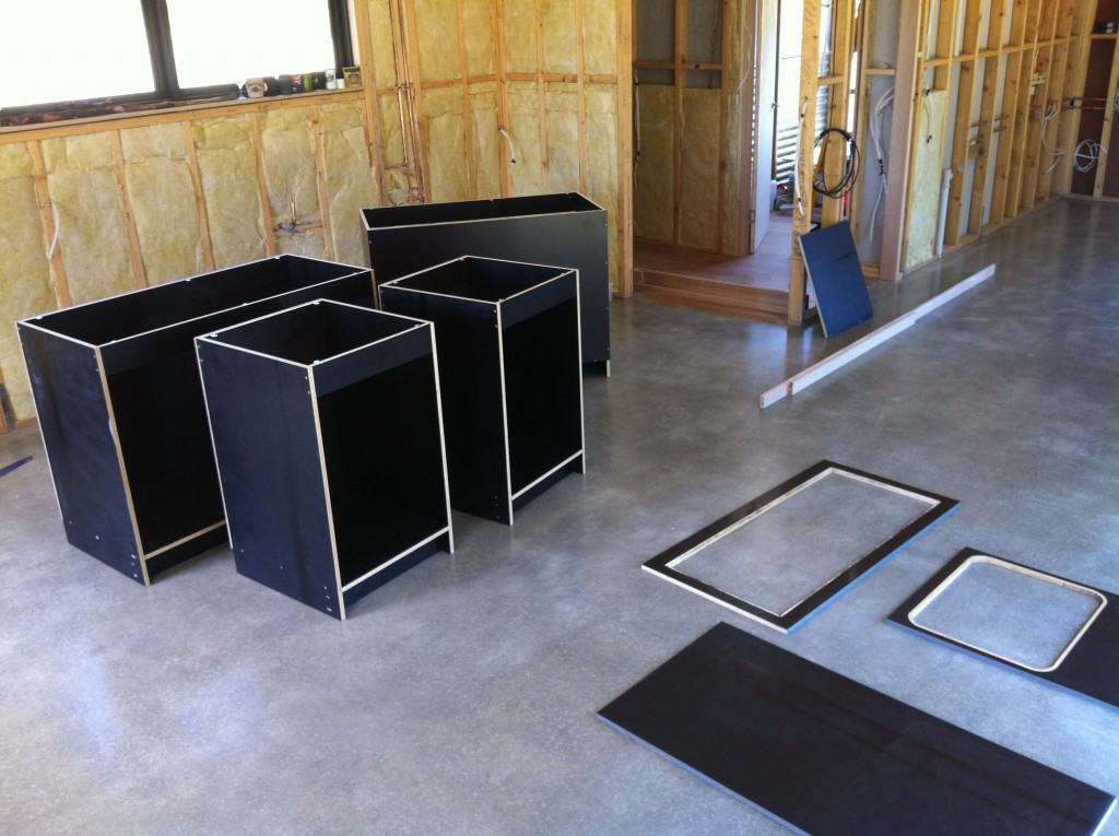 Kit of parts: the kitchen units and the tops, ready for assembly