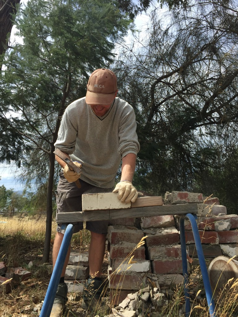 Hours of fun: cleaning bricks, by hand