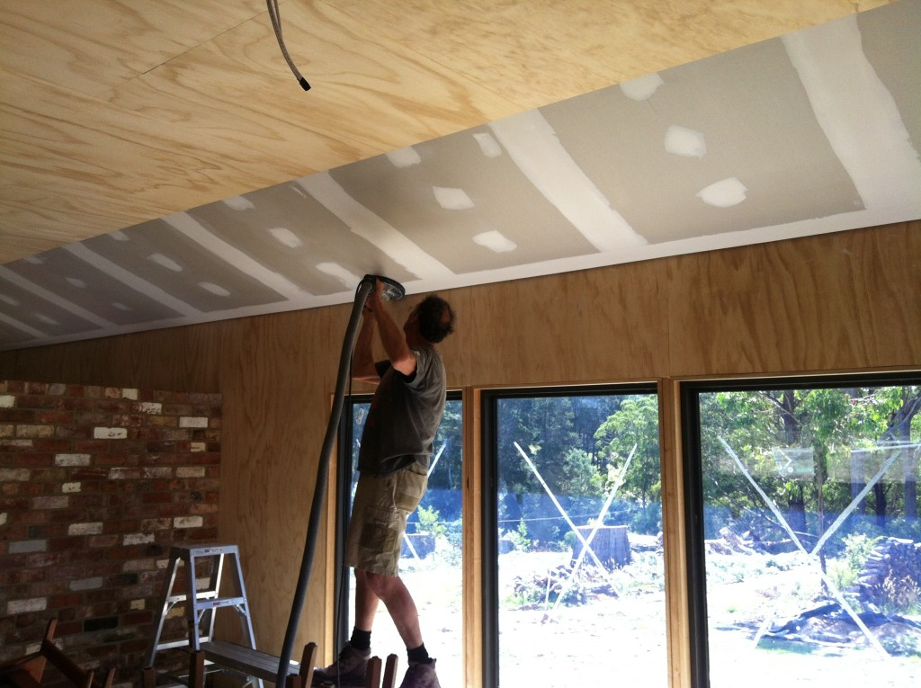 Dusty: Pete finishing the sanding of the plasterboard