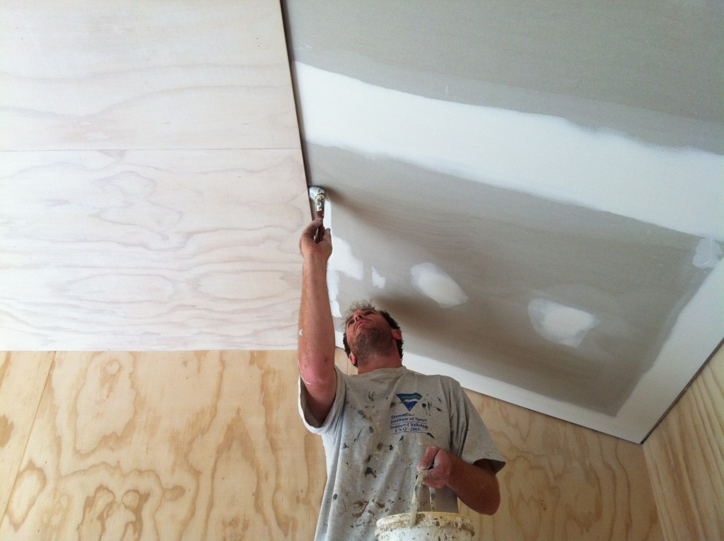 Cut shot: Gordon cutting in the edge of the plasterboard