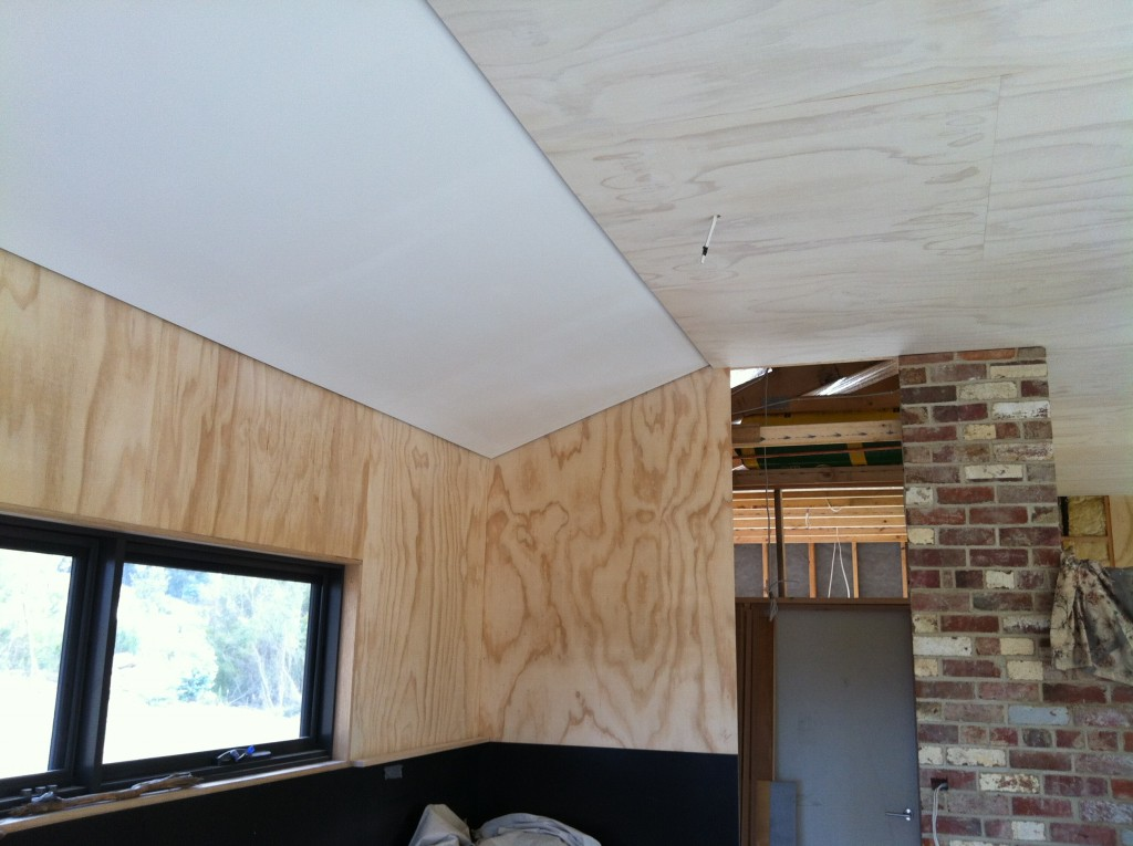 Cover: the ceiling after two coats of paint on the plasterboard