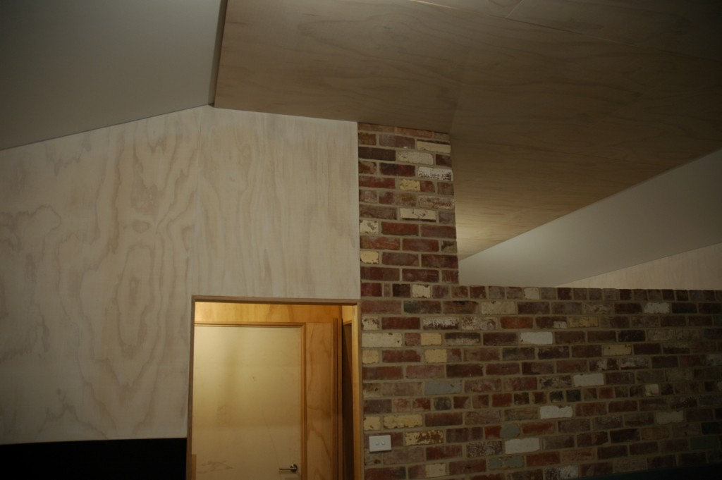 Warm: the whitewash walls and ceiling and recycled brick wall