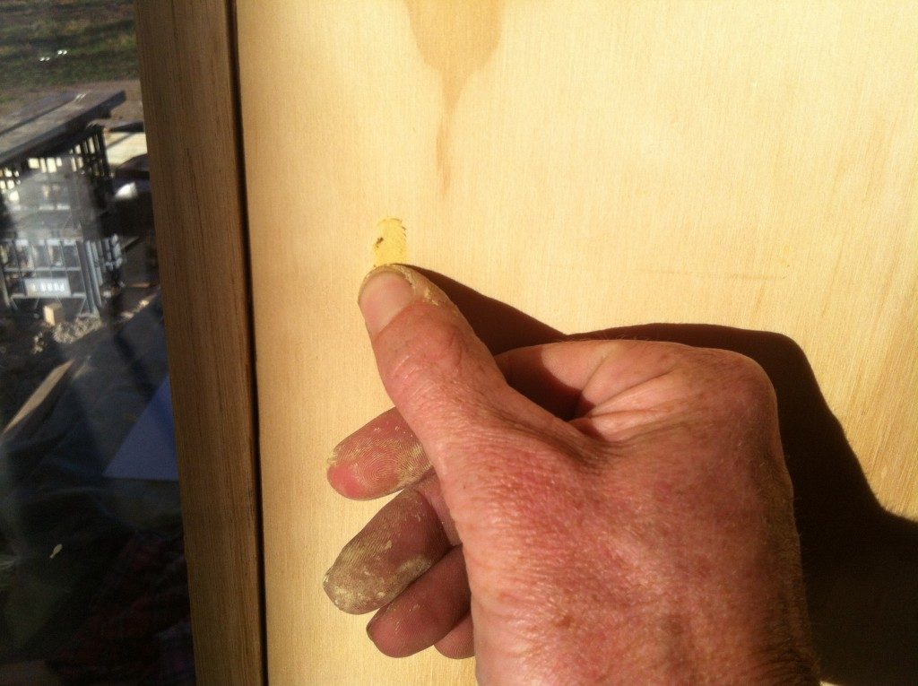 Push it: filling the nail holes with putty