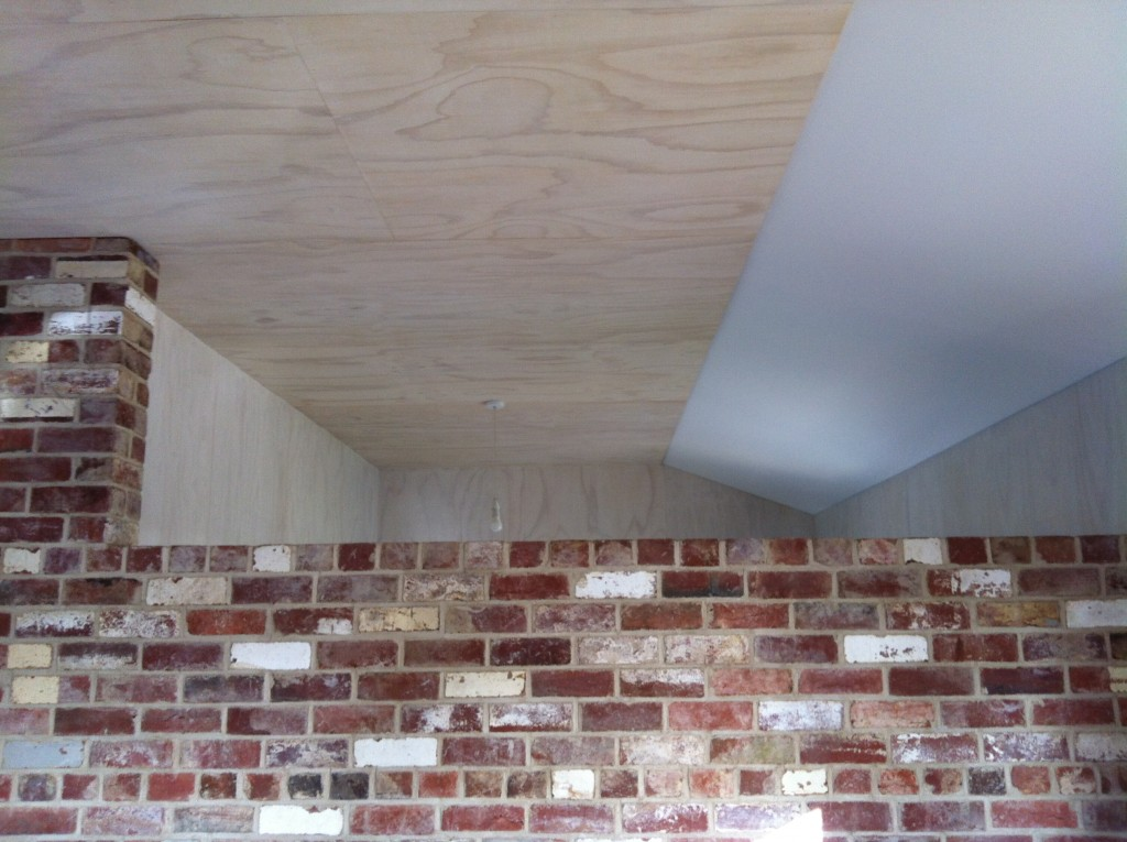 Over the wall: looking from the living area into the bedroom