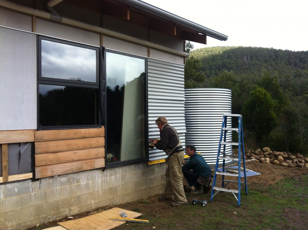 Temp job: Greg and Pete fixing a section of Colorbond sheeting for cladding