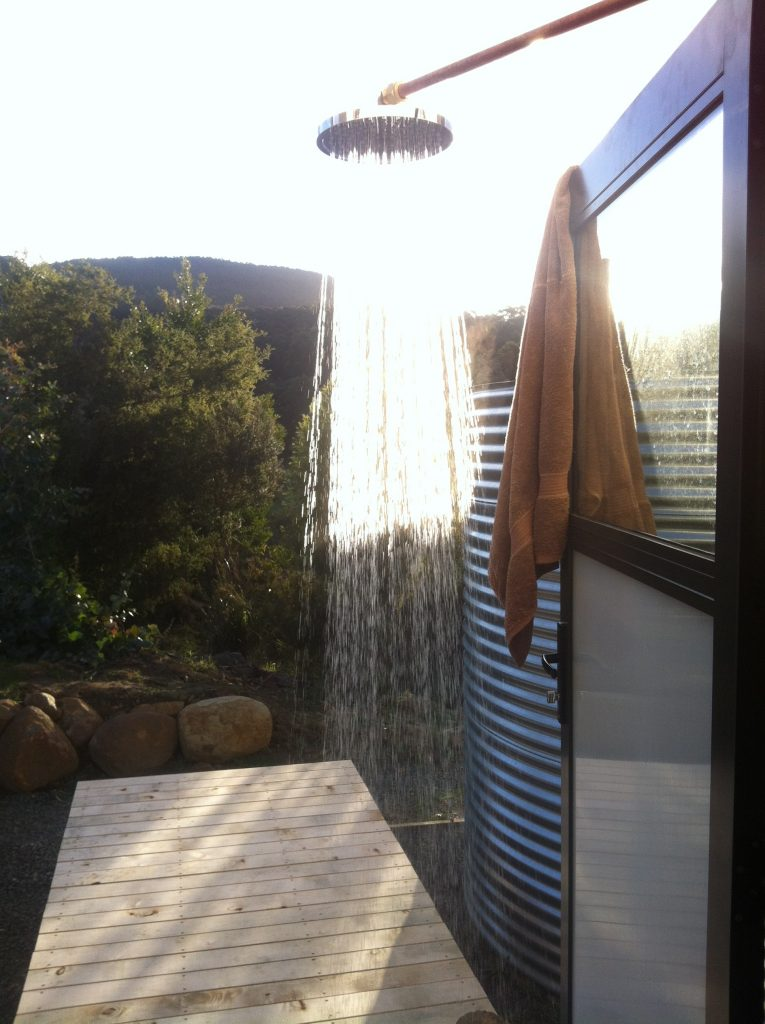 Hot stuff: running water for the outside shower in the late arvo sun