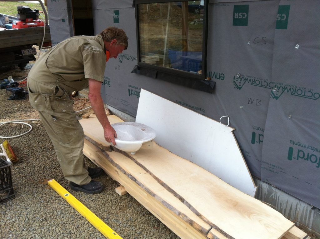 There you go: Greg figuring out where to place the basin in the Huon Pine vanity