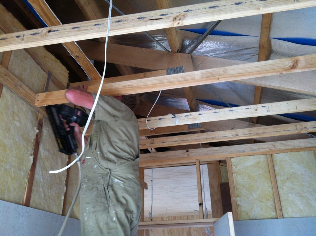 Hold on: Greg framing up the bathroom ceiling