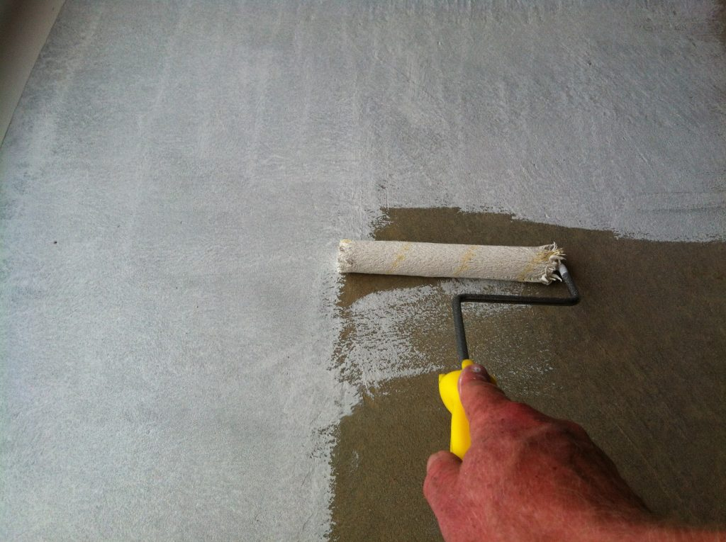 Thirsty: the raw concrete soaked up the first coat of epoxy